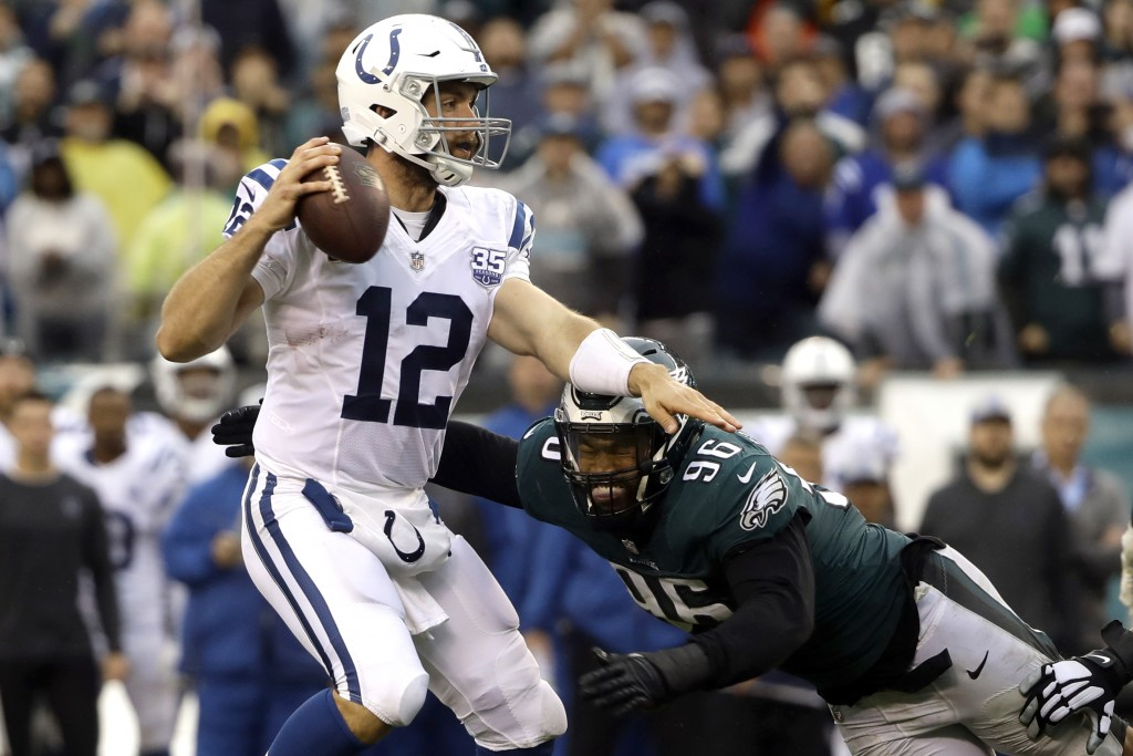 Indianapolis Colts' Andrew Luck (12) is hit by Philadelphia Eagles' Derek Barnett (96) during the second half of an NFL football game, Sunday, Sept. 2