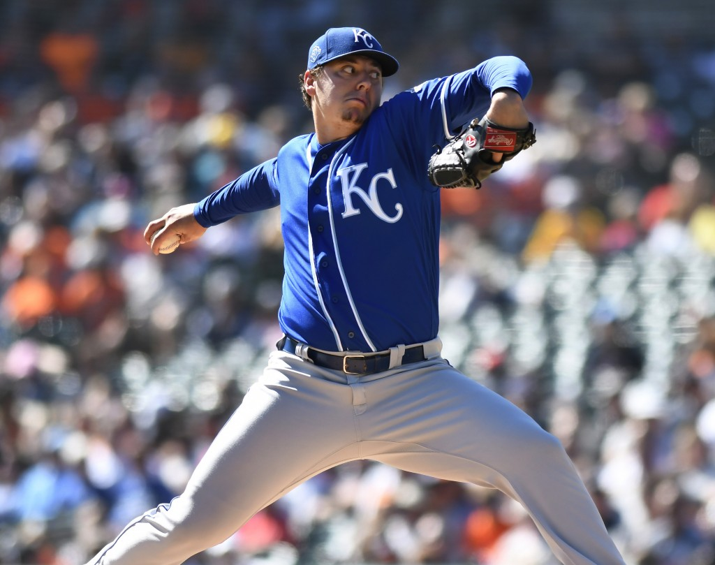 Kansas City Royals starting pitcher Brad Keller throws against the Detroit Tigers during the first inning of a baseball game in Detroit, Sunday, Sept.