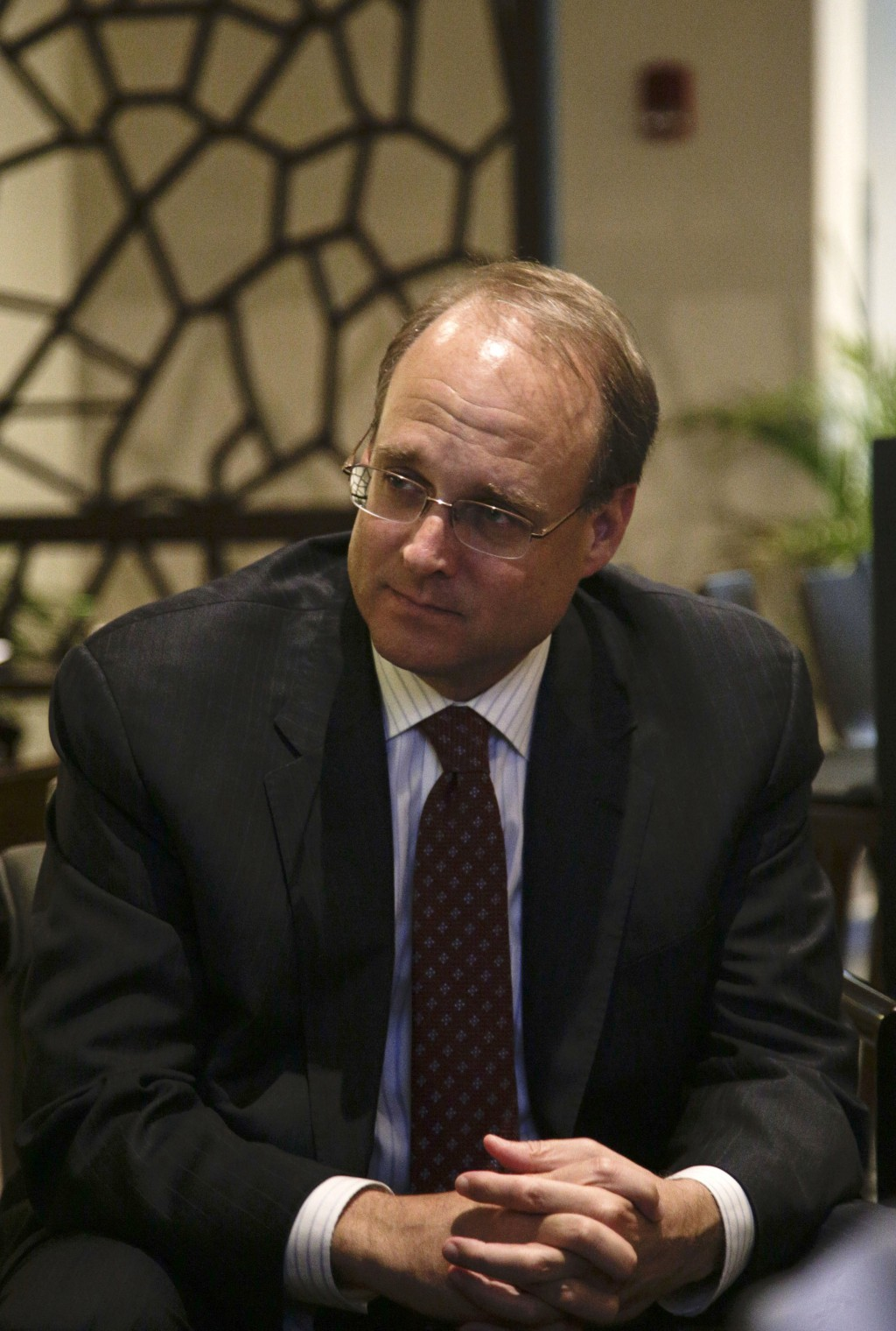 In this June 1, 2018 photo, Marshall Billingslea, assistant U.S. Treasury Secretary for Terrorist Financing, listens to questions during a interview i...