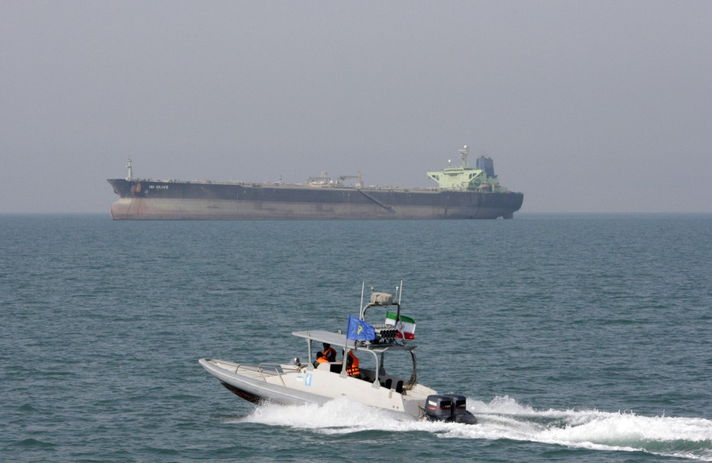 FILE-- In this July 2, 2012 file photo, an Iranian Revolutionary Guard speedboat moves in the Persian Gulf while an oil tanker is seen in background. ...
