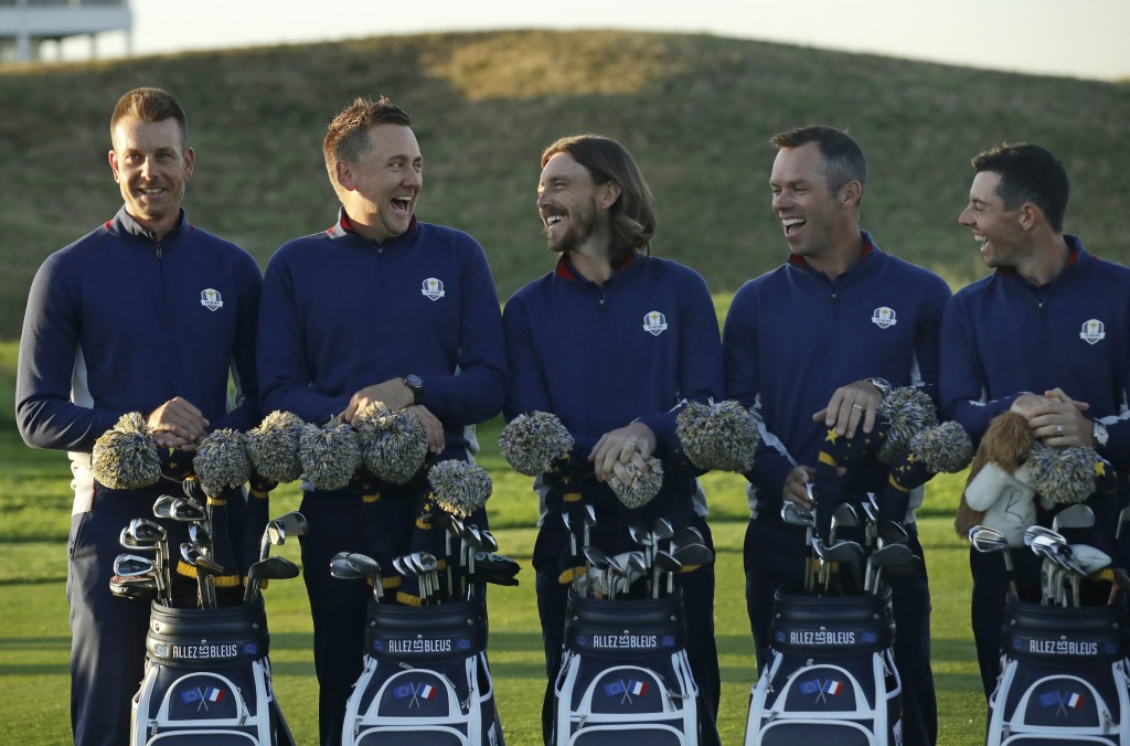 Europe's Henrik Stenson, Ian Poulter, Tommy Fleetwood, Paul Casey and Rory McIlroy, from left, share a joke during the European Ryder Cup team photo a...