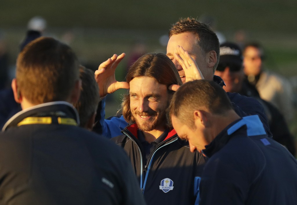 Europe's Ian Poulter, rear, jokes with Europe's Tommy Fleetwood before the European Ryder Cup team photo at Le Golf National in Guyancourt, outside Pa...