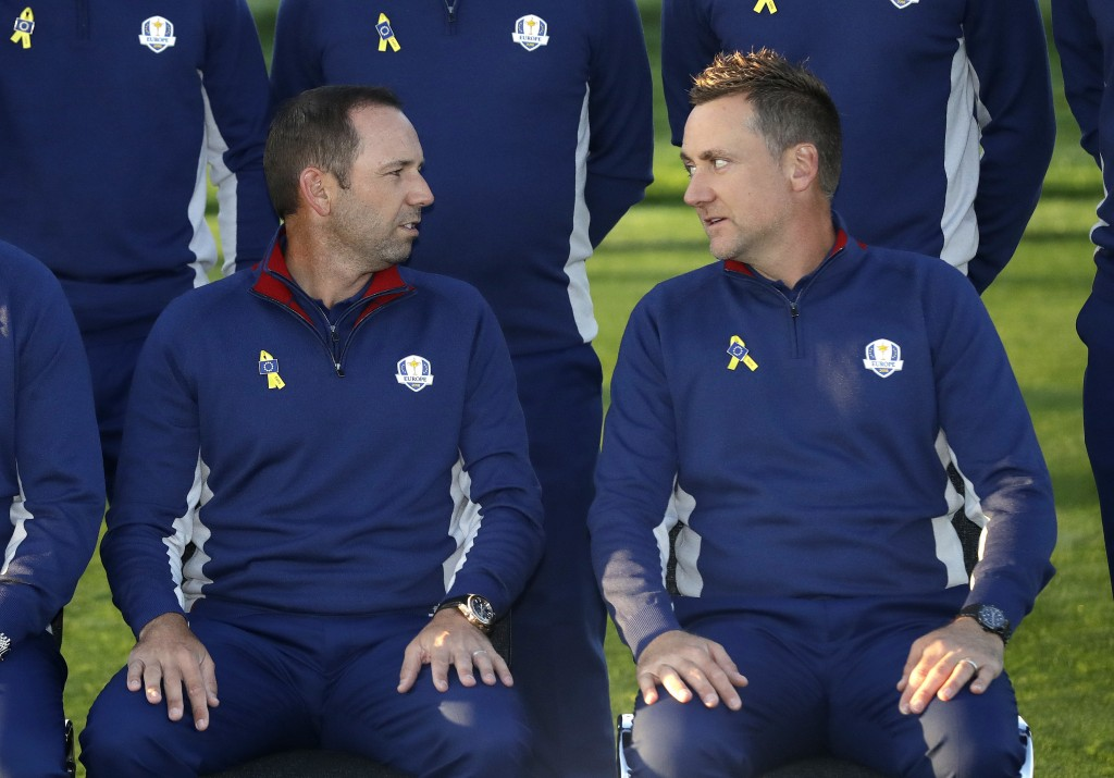 Europe's Sergio Garcia, left, and Ian Poulter look at each other during the European Ryder Cup team photo at Le Golf National in Guyancourt, outside P...