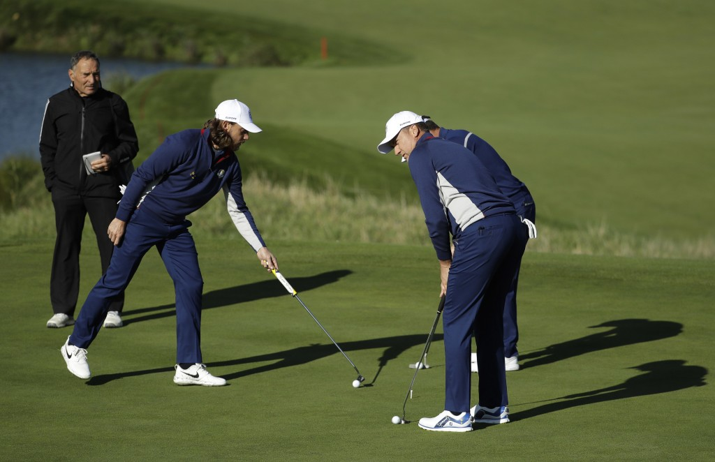 Europe's Tommy Fleetwood and Europe's Ian Poulter, right, put on the 10th green during a practice round at Le Golf National in Guyancourt, outside Par...