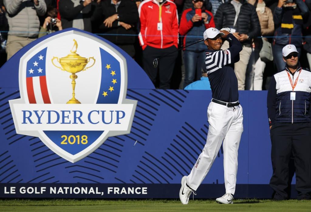 Tiger Woods of the US drives the ball from the 10th during a practice round for the Ryder Cup at Le Golf National in Saint-Quentin-en-Yvelines, outsid...