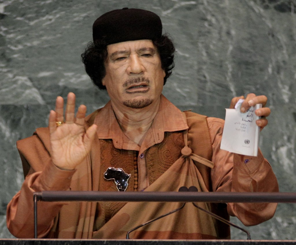 FILE - In this Sept. 23, 2009 file photo, Libyan leader Moammar Gadhafi shows a torn copy of the U.N. Charter during his address to the 64th session o...
