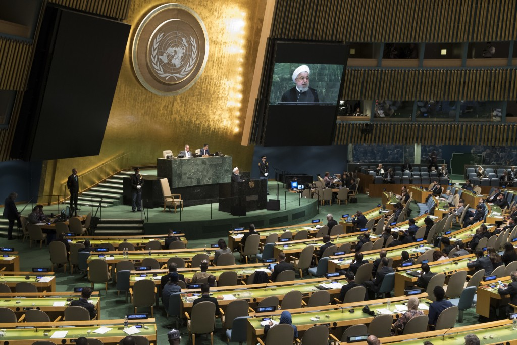 Iranian President Hassan Rouhani addresses the 73rd session of the United Nations General Assembly, Tuesday, Sept. 25, 2018 at U.N. headquarters. (AP ...