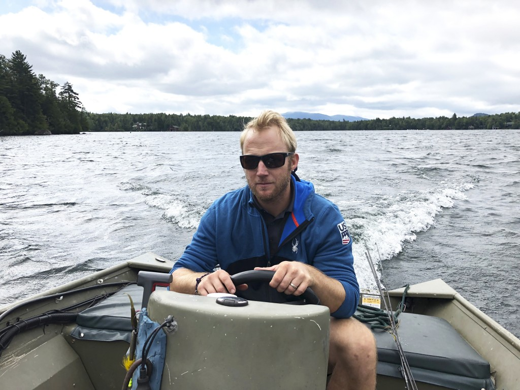 "In this Sept. 1, 2018, photo, Andrew Weibrecht, aka ""War Horse,"" pilots his boat on Lake Placid in the Adirondack Mountains of New York. The two-time ..."
