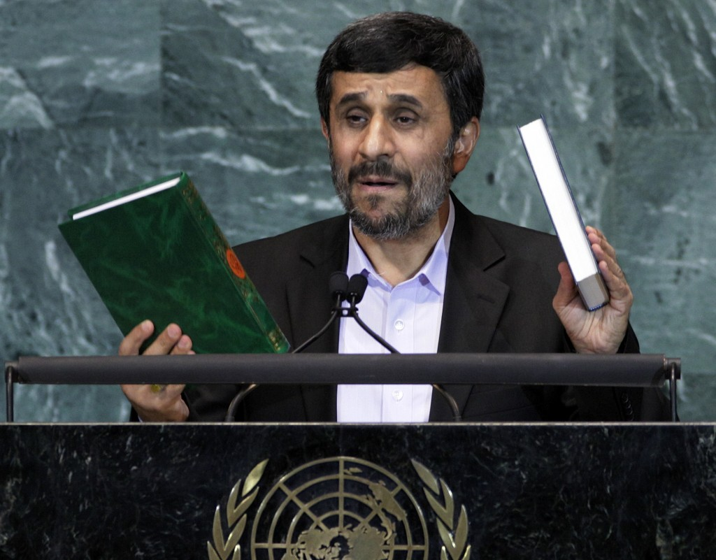 FILE - In this Sept. 23, 2010 file photo, Mahmoud Ahmadinejad, President of Iran, holds up a copies of the Quran, left, and Bible, right, as he addres