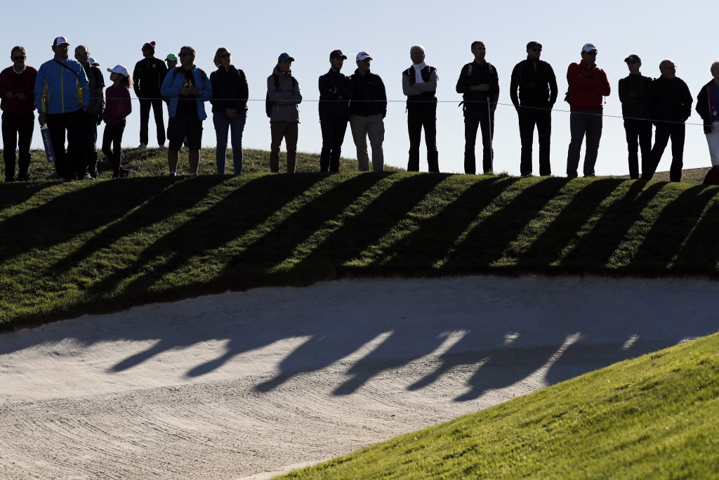 Fans watch European players during a practice round for the 2018 Ryder Cup in Saint-Quentin-en-Yvelines, outside Paris, France, Wednesday, Sept. 26, 2...