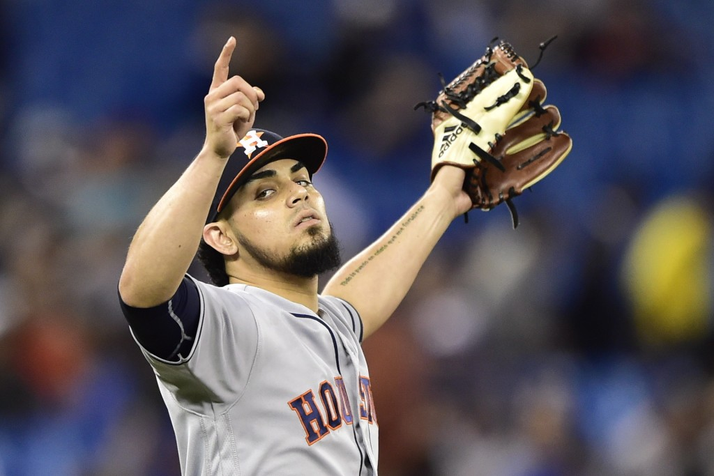 Houston Astros relief pitcher Roberto Osuna celebrates after the Astros defeated the Toronto Blue Jays in a baseball game Tuesday Sept. 25 2018