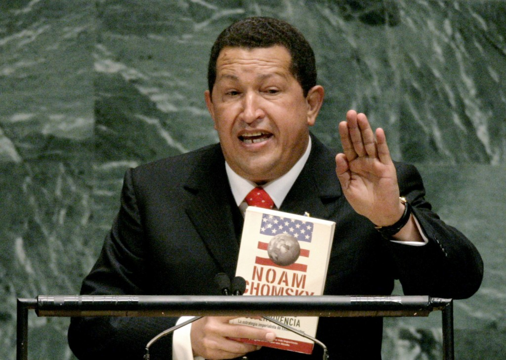 FILE - In this Sept. 20, 2006 file photo, Venezuelan President Hugo Chavez holds a Spanish language version of Hegemony or Survival: America's Quest f