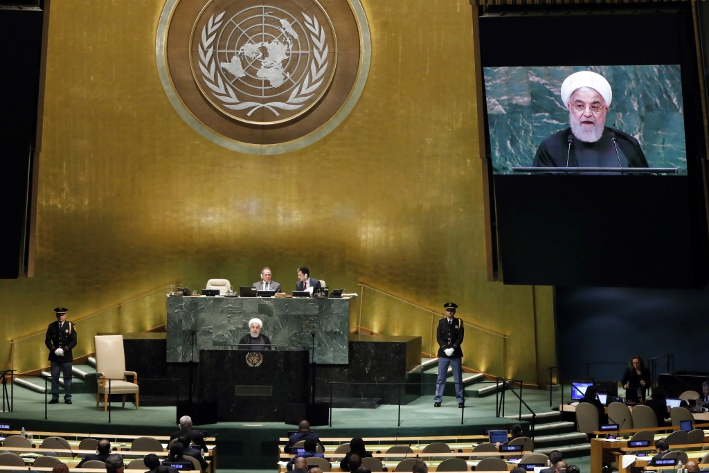 Iran's President Hassan Rouhani addresses the 73rd session of the United Nations General Assembly, at U.N. headquarters, Tuesday, Sept. 25, 2018. (AP ...