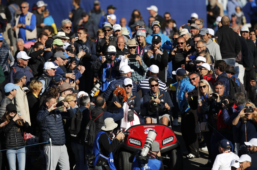 Tiger Woods of the US arrives in a buggy to start a practice round for the Ryder Cup at Le Golf National in Saint-Quentin-en-Yvelines, outside Paris, ...