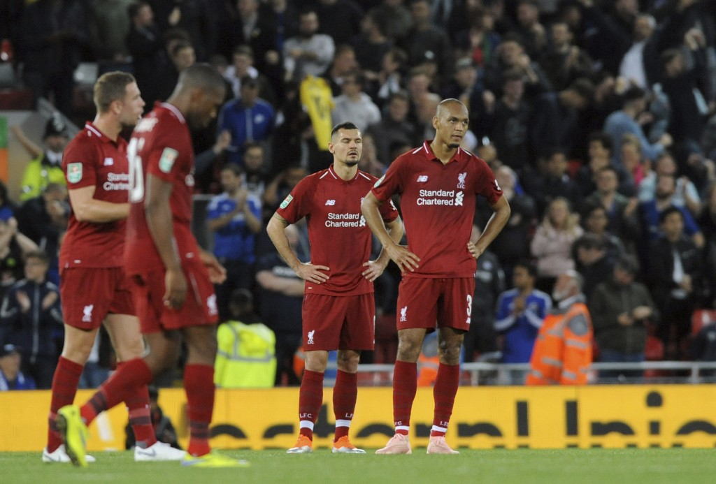 Liverpool players react after Chelsea's Eden Hazard scoring his side's second goal during the English League Cup soccer match between Liverpool and Ch