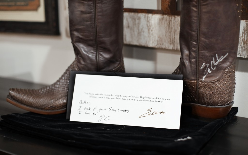 In this Sept. 25, 2018, photo, a pair of boots autographed by country music star Eric Church and a note from him are displayed in the home of Heather ...