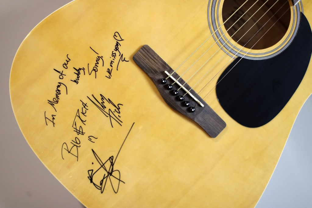 In this Sept. 25, 2018, photo, a guitar autographed by the country music duo Big and Rich is displayed on a wall in the home of Heather Melton in Big ...