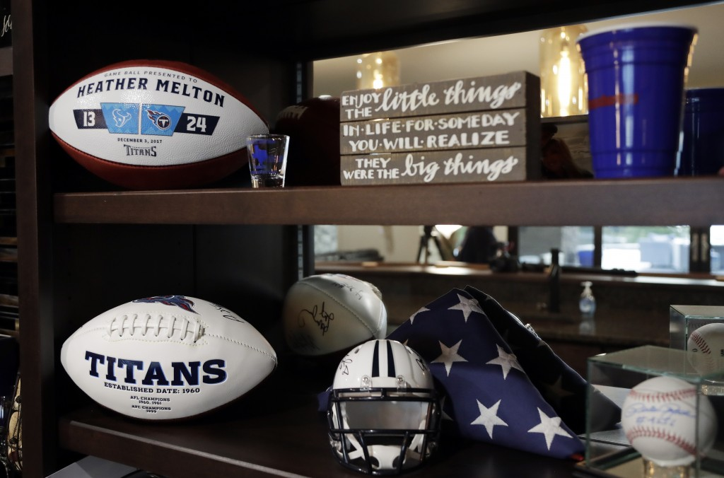 In this Sept. 25, 2018, photo, footballs given to Heather Melton by the Tennessee Titans are displayed in her home in Big Sandy, Tenn. Heather's husba...