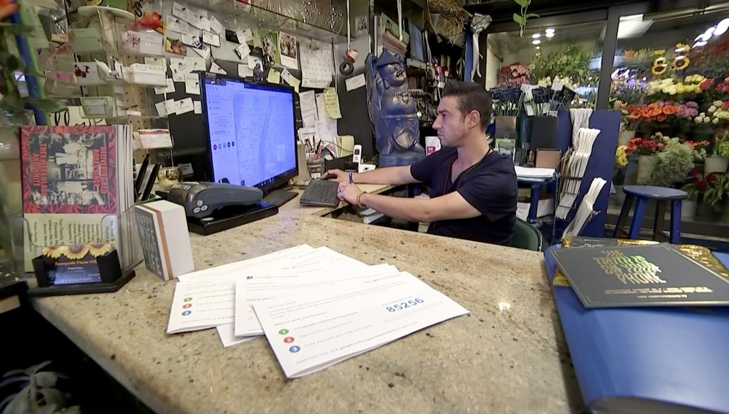 In this Monday, Sept. 10, 2018, image made from a video Greg Psitos works on a computer in the Queens borough of New York. In February, someone took o...