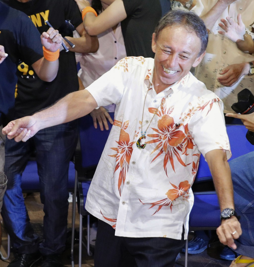 Japan's legislator Denny Tamaki celebrates his victory, dancing with supporters in the election for Okinawa governor in Naha city, Sunday, Sept 30, 20...