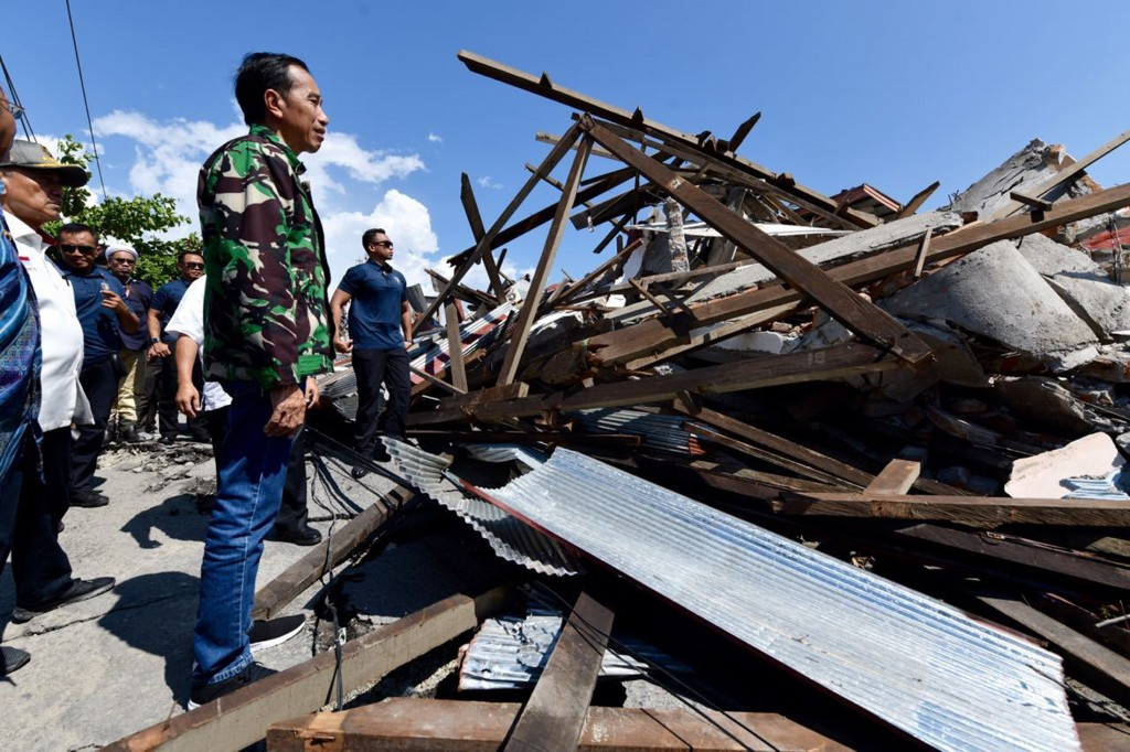 In this Sunday, Sept. 30, 2018, file photo released by the Indonesian Presidential Office, Indonesian President Joko Widodo walks through the damaged