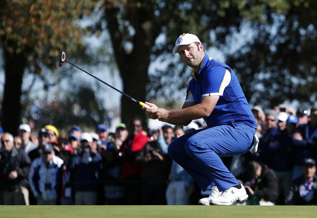 Europe's Jon Rahm watches his putt just miss on the 3rd green during a singles match on the final day of the 42nd Ryder Cup at Le Golf National in Sai...