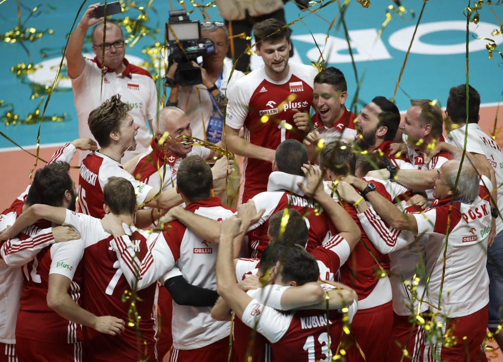 New world champions team Poland celebrate winning the Men's World Championships volleyball final match between Brazil and Poland, in Turin, Italy, Sun...