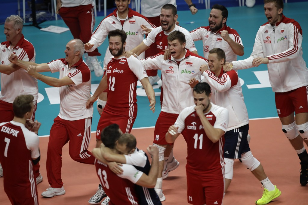 New World Champions team Poland celebrates winning the Men's World Championships volleyball final match between Brazil and Poland, in Turin, Italy, Su...