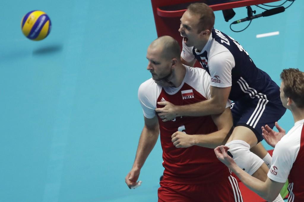 Polish payers celebrate with Bartosz Kurek, center, after winning the first set in the Men's World Championships volleyball final match between Brazil...