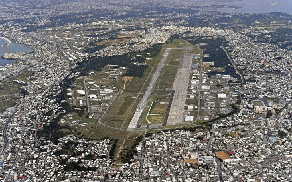 This Jan. 27, 2018 aerial photo shows U.S. Marine Air Station Futenma in Ginowan, Okinawa, southern Japan. The election of an outspoken critic of the ...