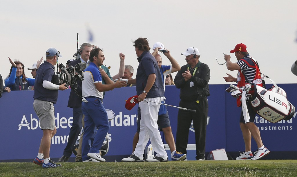 Phil Mickelson of the US concedes his singles match to Europe's Francesco Molinari for Europe to clinch the Ryder Cup on the final day of the 42nd Ryd...