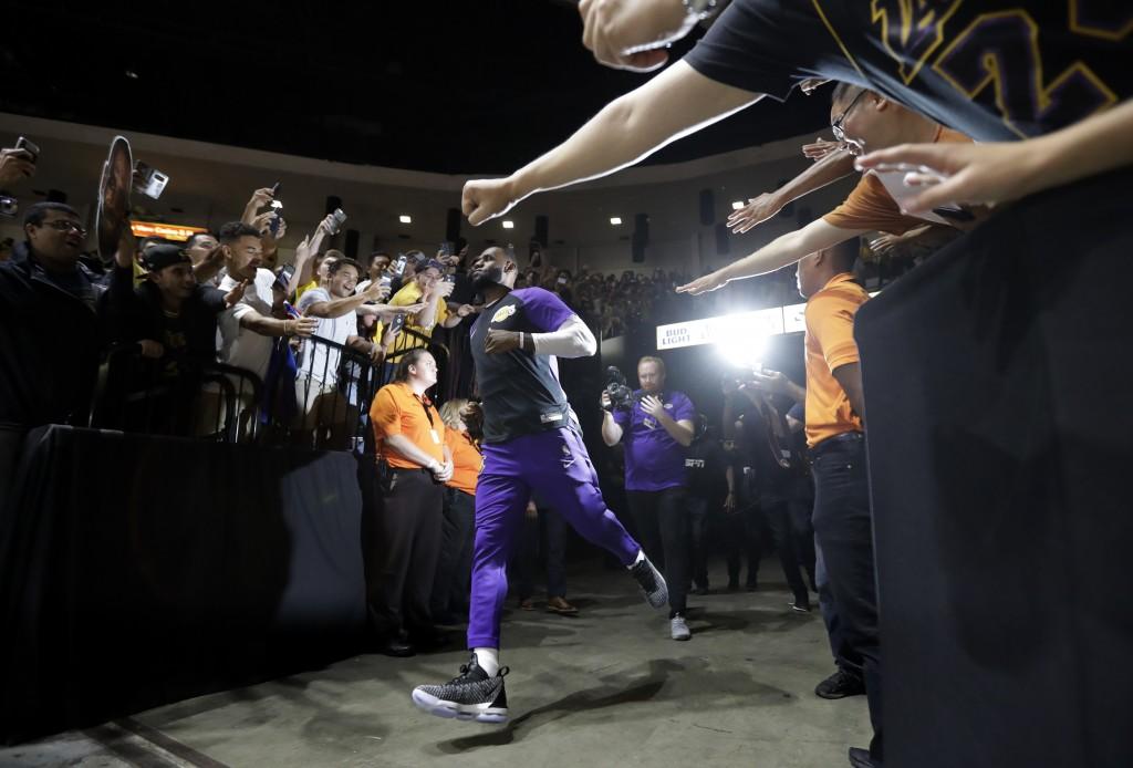 6f0c8ef278e Los Angeles Lakers forward LeBron James runs past fans on his way to the  court before