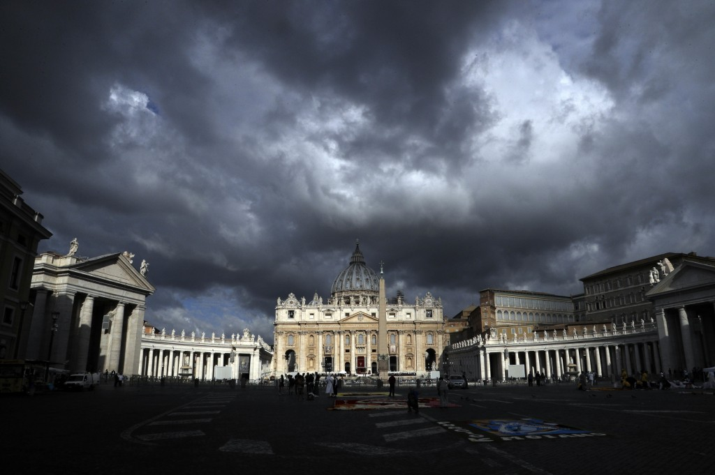 FILE - In this June 29, 2017 file photo, clouds hang over St. Peter's Basilica, at the Vatican.  Despite the dark cloud hanging over a synod of bishop...