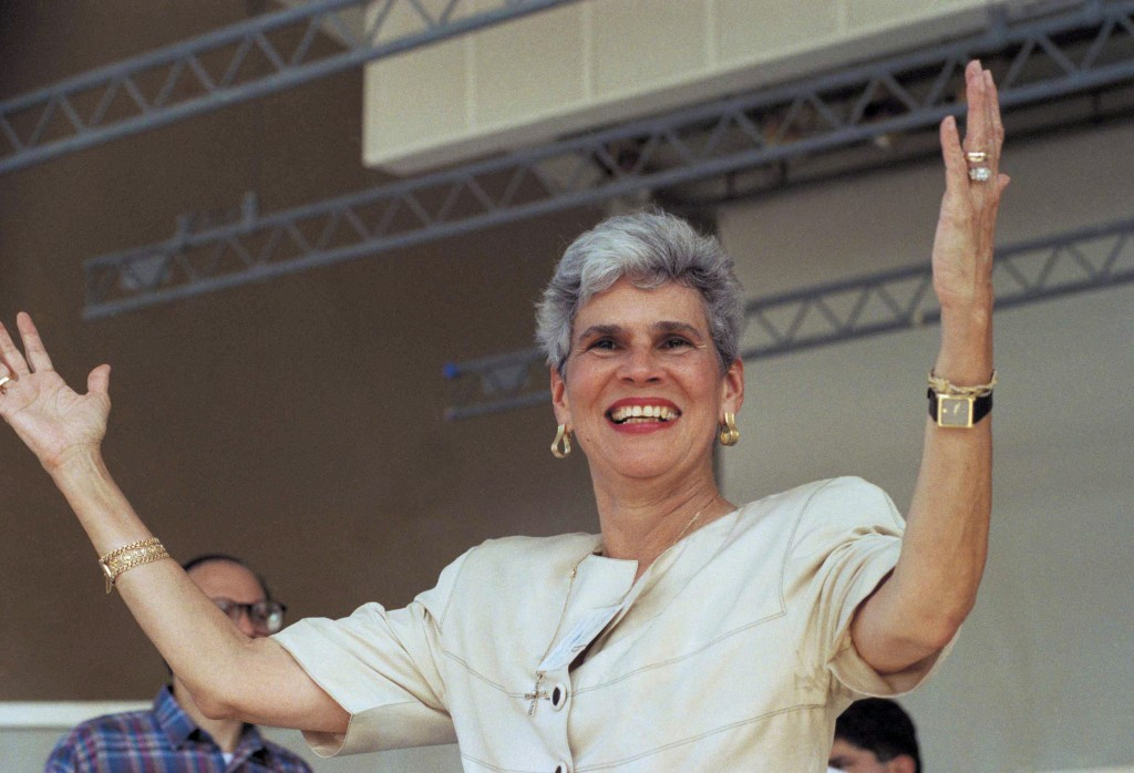 FILE - In this Sept. 17, 1989 file photo, Nicaraguan presidential candidate Violeta Chamorro raises her arms as she receives a warm welcome from some