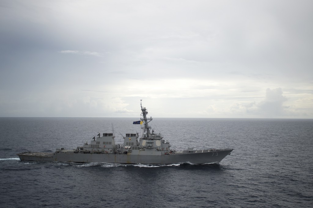 FILE - In this Oct. 13, 2016, file photo provided by the U.S. Navy, guided-missile destroyer USS Decatur (DDG 73) operates in the South China Sea as p...