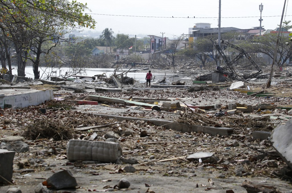 A man walks past the remains of structures at a park after it was destroyed in the massive earthquake and tsunami that hit Palu, Central Sulawesi, Ind...