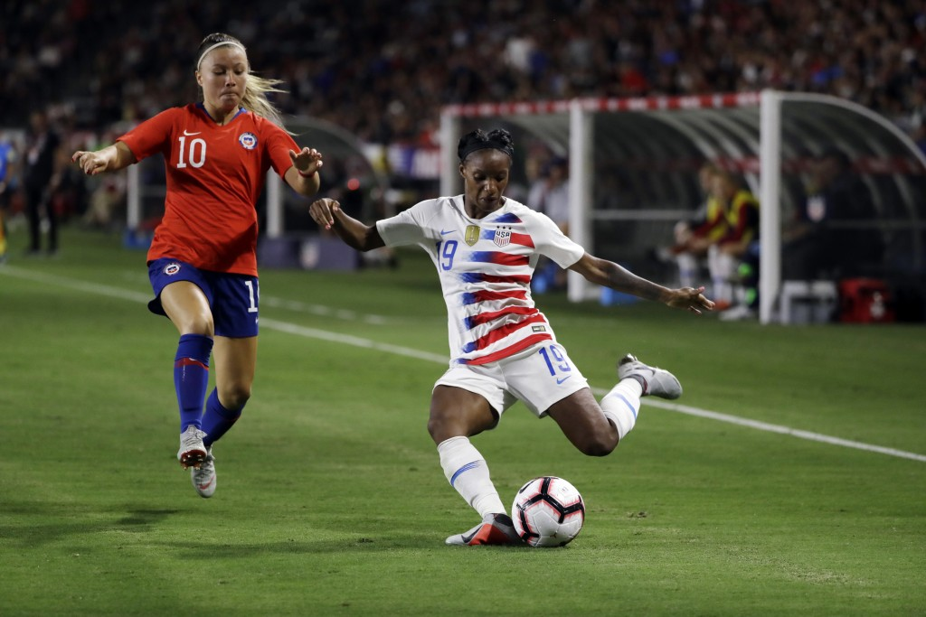 FILE - In this Aug. 31, 2018, file photo, United States' Crystal Dunn, right, prepares to strike the ball during the second half of an international f