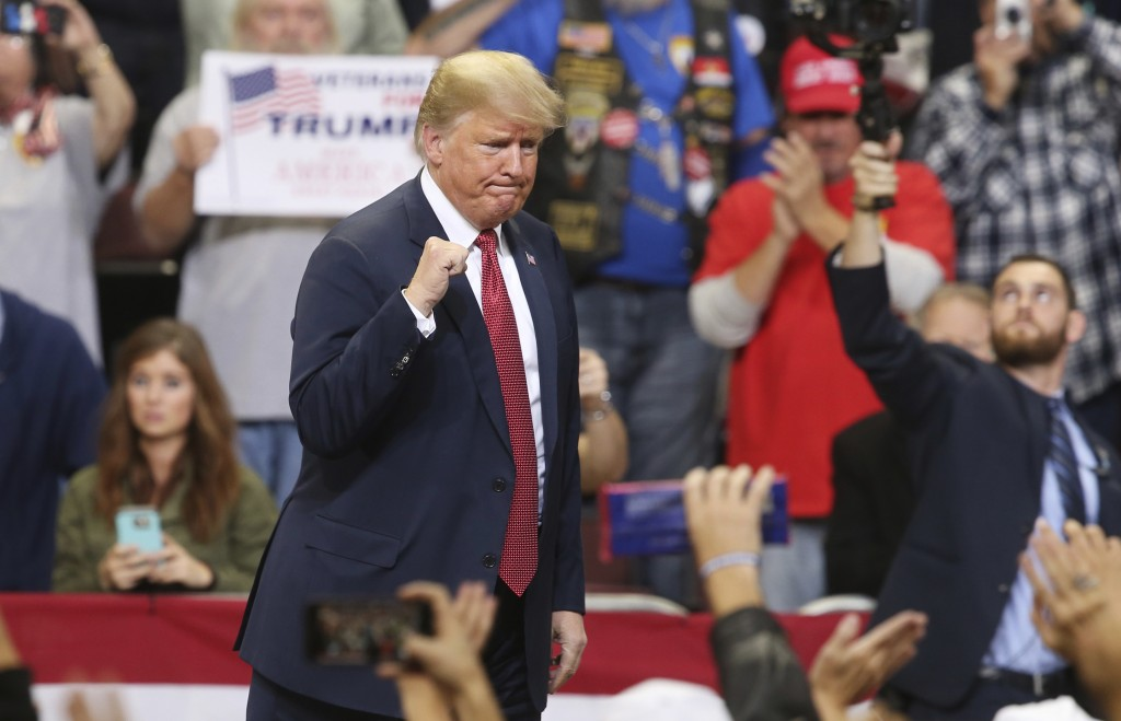In this Oct. 4, 2018 photo, President Donald Trump pumps his fist as he leaves after speaking at a campaign rally in Rochester, Minn. Trump was kickin...