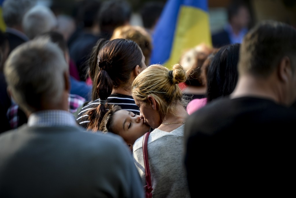 A woman kisses her son during a rally in support of the traditional family, organised by the local church, in the small province town of Draganesti Ol...
