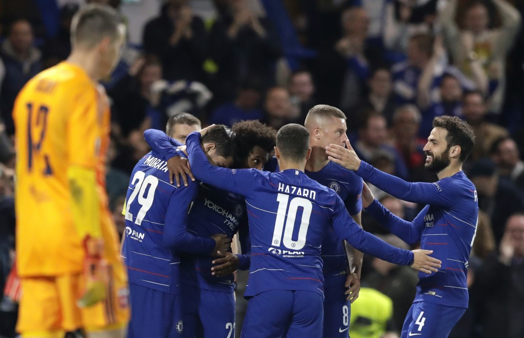 Chelsea players celebrate after scoring the opening goal during the Europa League group L soccer match between Chelsea and Vidi FC at Stamford Bridge