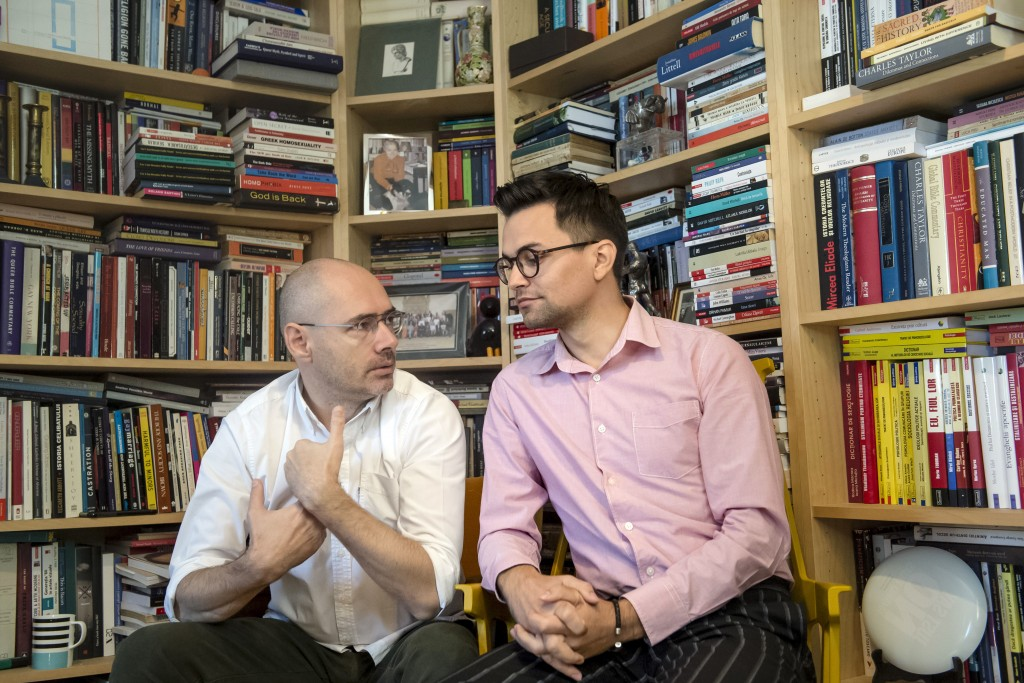 Gay rights activist Florin Buhuceanu, left, and his partner Victor Ciobotaru, a gender and political studies student, talk during an interview with th...