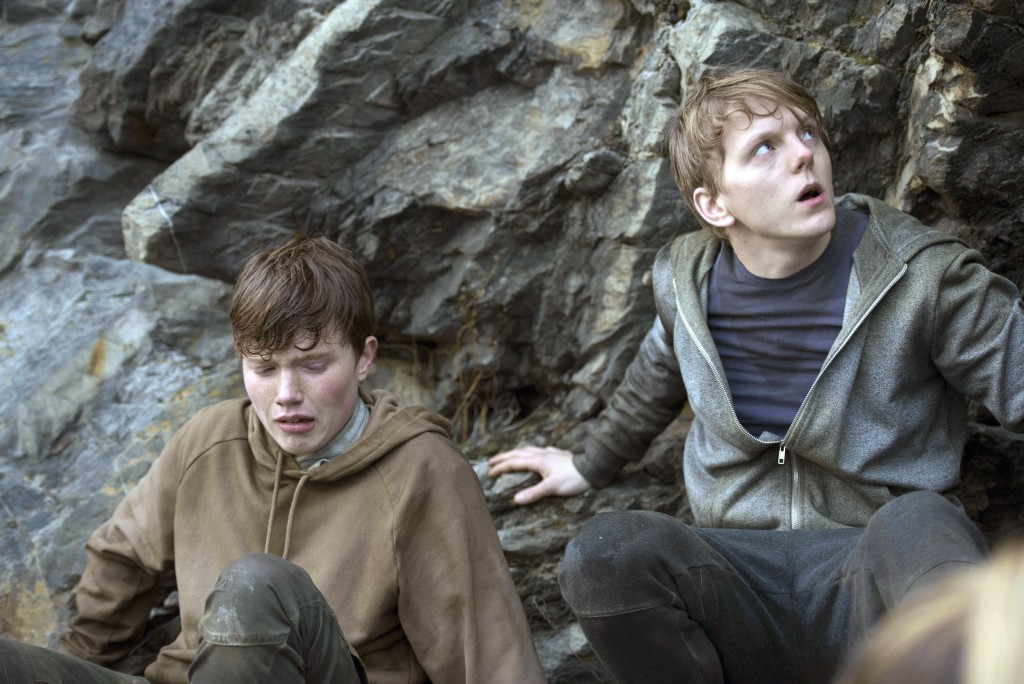 """This image released by Netflix shows Isak Bakli Aglen, left, and Jonas Strand Gravli in a scene from """"22 July,"""" a docudrama about the 2011 Norway terr"""