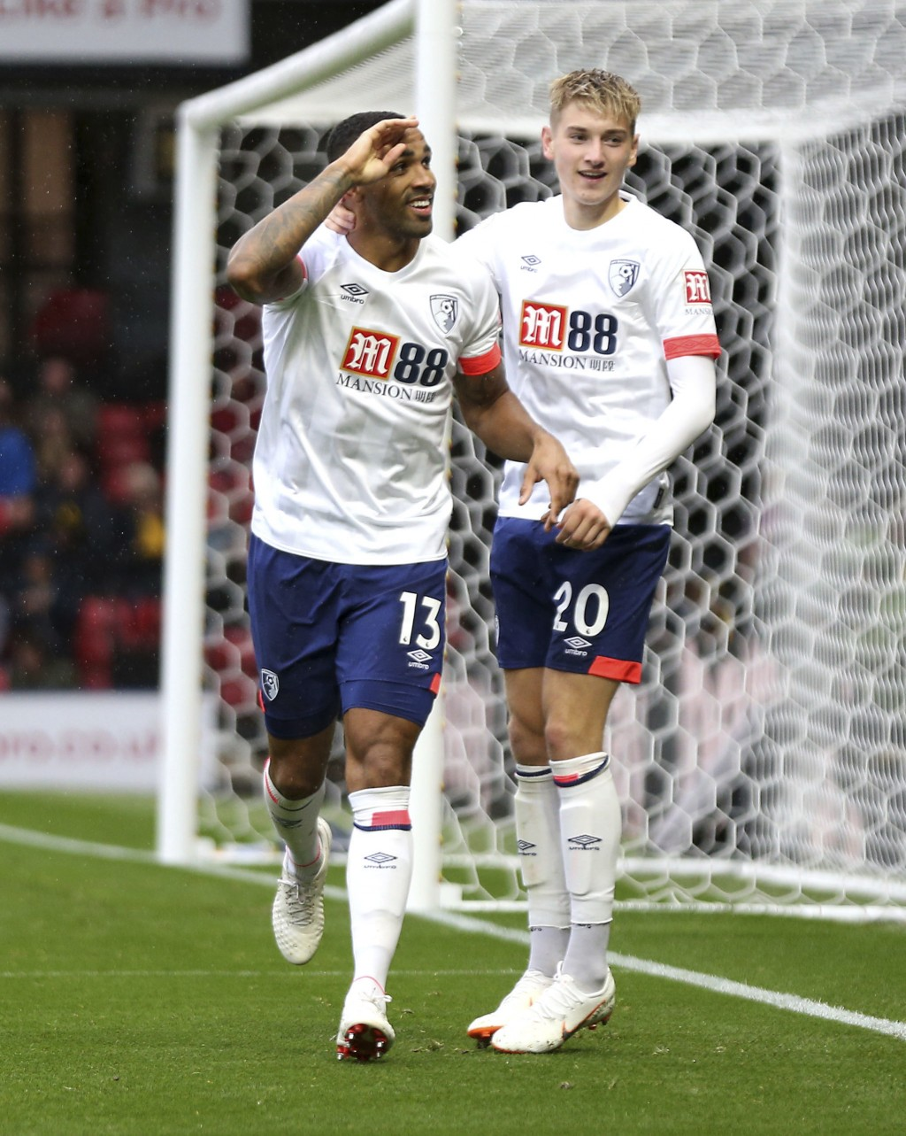 Bournemouth's Callum Wilson, left, celebrates scoring against Watford during the English Premier League soccer match at Vicarage Road, Watford, Englan...
