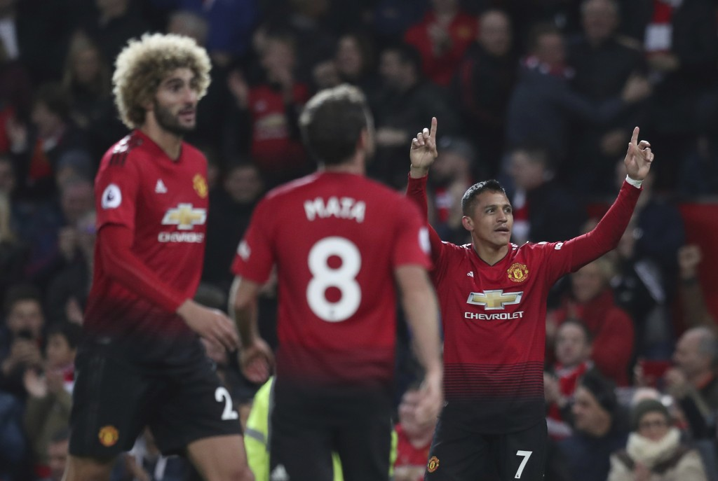 Manchester United's Alexis Sanchez celebrates after scoring his sides 3rd goal during their English Premier League soccer match between Manchester Uni...