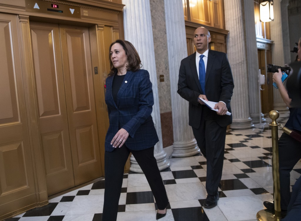 Senate Judiciary Committee members Sen. Kamala Harris, D-Calif., left, and Sen. Cory Booker, D-N.J., arrive at the chamber for the final vote to confi