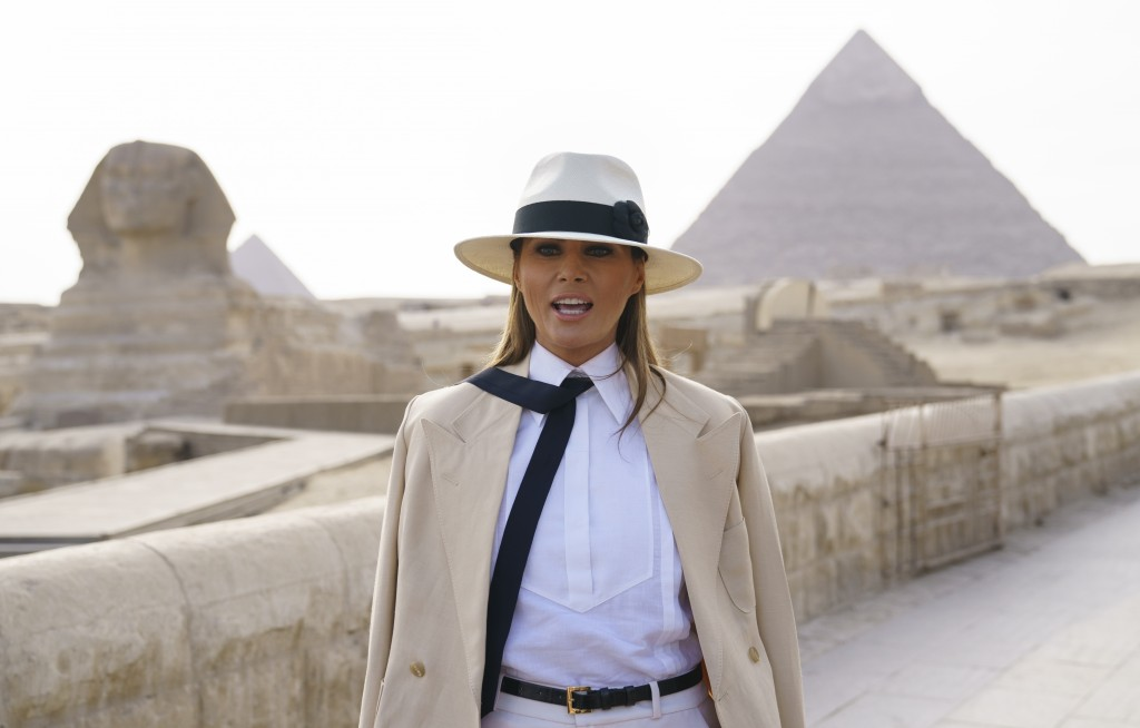 U.S. first lady Melania Trump talks to media as she visits the ancient statue of Sphinx, with the body of a lion and a human head, at the historic Giz