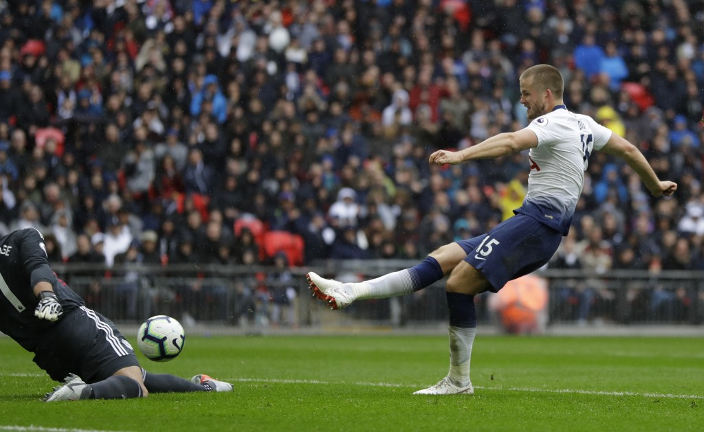 Tottenham's Eric Dier scores his side's opening goal during the English Premier League soccer match between Tottenham Hotspur and Cardiff City at Wemb...