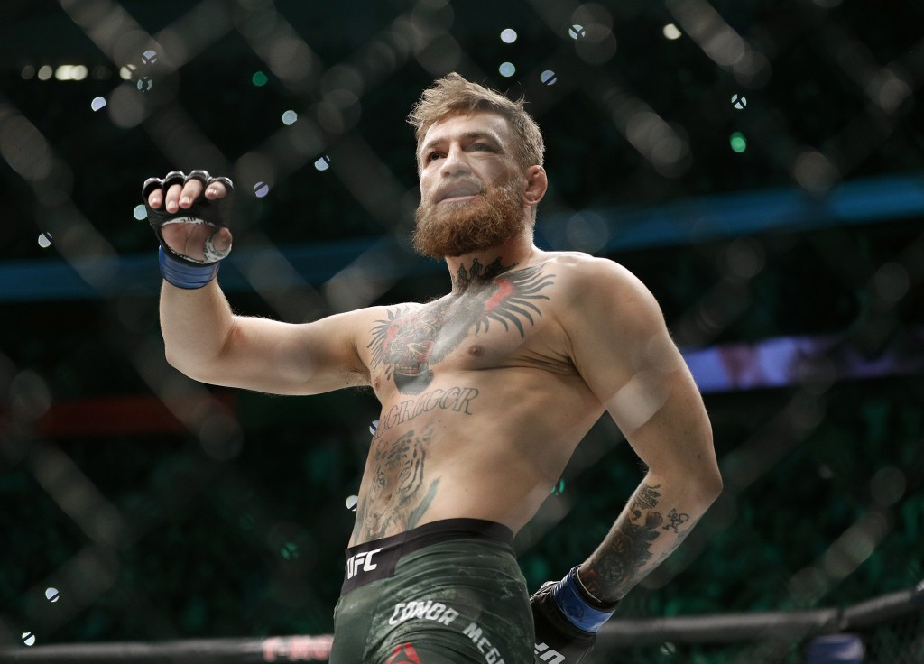 Conor McGregor walks in the cage before fighting Khabib Nurmagomedov in a lightweight title mixed martial arts bout at UFC 229 in Las Vegas, Saturday,