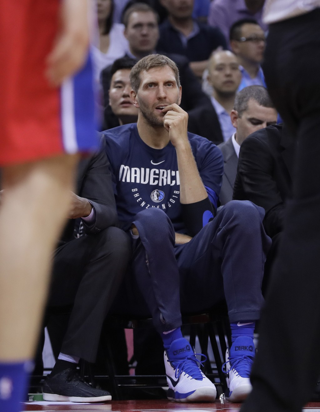Dirk Nowitzki of the Dallas Mavericks, center, gestures during the Shenzhen basketball match between the Philadelphia 76ers and the Dallas Maverick, p