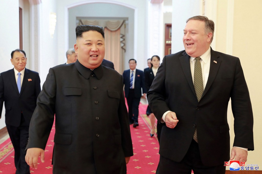 In this Oct. 7, 2018, photo provided by the North Korean government, North Korean leader Kim Jong Un, center left, and U.S. Secretary of State Mike Po